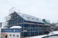 Massives Gebäudehülle aus Holz hier mit energieeffizienter Isolierung